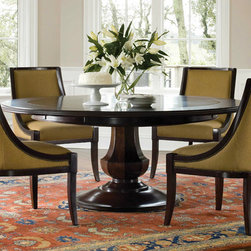 Sienna Dining Table - I've always loved round dining tables the best because they make it easy for everyone to see and talk with each other without having to lean over to see past the person next to them. Most of the time, when a round table has leaves, it turns into an oblong which gives you those flat sides. But this one turns into a larger round table. Brownstone's Sienna Table ($3,735) goes from a 56-inch diameter that seats four to six people, up to a 72-inch diameter that seats 10. The style is so simple and classic it will work with traditional or transitional decor. Individual soft felt bags are provided to protect the extensions from scratches while stored.