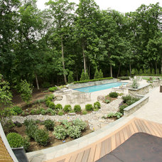 Traditional Pool by Land & Water Design