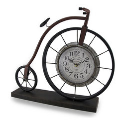 Zeckos - Vintage Style High Wheeler Kensington Station Accent Clock - This unique clock features a vintage style high wheeler bicycle design with a large front wheel featuring a 5 5/8 inch diameter clock. The clock runs on a quartz movement and requires 1 AA battery (not included). The clock sits in the middle of the wheel with large, easy to read markers, ornate hands and is highlighted with 'Kensington Station London 1879' in the middle. Crafted from metal, it measures 15 3/8 inches (40 cm) high, 18 inches (46 cm) long and 3 1/2 inches (9 cm) wide. It's a fun tribute to the history of cycling with a lightly weathered hand-painted black and brown finish perfect for your home or office, and it makes a great gift for the cyclist with a love of history in your life