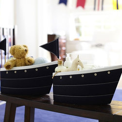 Fabric Sailboat Changing Table Storage - These fabric storage boats are awesome. Storage is a necessity for any child's space, and the fact that these are shaped like boats may get the kids enthusiastic about putting things away.
