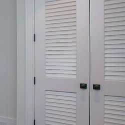 "Louver/Louver Doors - Make a louver door look upscale with over 2"" wide louver blades.   Supa Doors are built to order and can be customized freely.   Made from 86% recycled wood content, the doors are environmentally friendly and are warrantied for life."