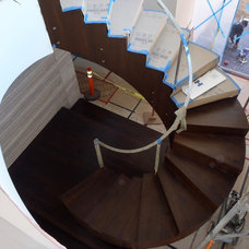 Contemporary Staircase by Prestige Builders