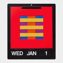 PERPETUAL wall calendar - A calendar that never goes out of date. Dan Reisinger's dynamic and boldly interactive calendar encourages the user to create beautiful combinations of color and composition with over 46,000 image variations. A sturdy metal frame holds six reversible bi-color cut-out sheets and cards which display the day of the week, month, and date.