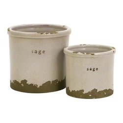 Sage Herb Pots - Set of 2 - The Sage Herb Pots - Set of 2 bring rustic charm to any space. Constructed from durable red clay, these two herb pots are kiln fired and finished with a white crackle glaze that enriches their texture. The unfinished, rough edges are exposed to further the aged aesthetic.About IMAXWhat began as a small company importing copper flower containers in 1984 by Al and Faye Bulak has developed into one of the top U.S. import companies serving the At Home market today. IMAX now provides home and garden accessories imported from twelve countries around the world, housed in a 500,000 square foot distribution center. Additional sourcing, product development and showroom facilities in the USA, India and China make IMAX a true global source. They're dedicated to providing products designed to meet your needs. This is achieved through a design and product development team that pushes creativity, taste and fashion trends - layering styles, periods, textures, and regions of the world - to create a visually delightful and meaningful environment. At IMAX, they believe style, integrity, and great design can make living easier.