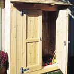 "Cedar Cubby with Paneled Door - Keep gardening tools, clay pots, and lots more neatly out of sight in this handy kiln dried cedar shed. Double doors feature heavy galvanized strap hinges, Ring Latch and chain bolt securing non-latching door. Screws together for easy assembly. Situate against a wall or anchor if freestanding (anchoring not supplied). Double doors each 20""wide. 63 1/4"" W, 30 1/4"" D, 85"" H. Motor Freight."