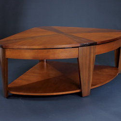 "Hammary - Oasis Wedge Lift-Top Cocktail Table in Rich Medium Brown Finish - A home knows that the world of furniture design is often a vast wasteland of dullness and unoriginality. Better to be safe and uninspired, some companies believe, than to be innovative and risk taking. At Hammary, we take a different view. Our unique ""Oasis"" collection breaks the mold of traditional, bland designs and makes any home a haven of elegance and panache. These transitional tables were created with today's casual interiors in mind: lavish enough to impress, but practical enough for everyday living. An exquisite combination of contrasting cherry andwalnut veneers creates an eye-catching, two-tone look. Soft rounded lines and extra-wide legs create an unmatched sense of flow and evenness. A rich, medium-brown finish- lightly burnished and hand-rubbed - adds an extra degree of class and complexity. The group includes both occasional pieces and afunctional entertainment console built to withstand the demanding use of today's active families. And the castered, lift-top table offers yet another pioneering feature that sets this collection apart from more mundane designs. If you're tired of the same old thing, look no further than Hammary. Why linger in the desert of boring furniture when you can come home to a sparkling ""Oasis""?; Oasis Collection; Finish: Rich Medium Brown; Lift Top; 2 Small Storage Compartments Under Lift-top; 1 Fixed Shelf: W40 D36 H12; Castered; Weight: 89 lbs.; Some assembly required; Dimensions: 40""W x 40""D x 19""H"