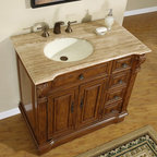 "Silkroad Exclusive - 38 in. Empress Single Sink Bathroom Vanity in - Undermount Ivory Ceramic Sink included. Travertine Stone Top included. Cabinet Finish: Cherry. Hardware Finish: Antique Brass. Materials: Wood, CARB Ph2 Certified Plywood & MDF Panels, Stone, Ceramic. Distressed Finish. Pre-drilled for 3-hole, 8-inch widespread Faucet(s). Faucet(s) not included. Dimensions: 38 in. W x 22 in. D x 36 in. H (177 lbs.)Single Sink Vanity with Roman Vein Cut Travertine Stone top and beautiful Cherry finish will surely give any bathroom the appeal that it deserves. You can also maximize your counter top and storage space up to 58"" with our optional matching drawer bank, which is available in our other listings. This elegantly designed Empire style vanity with modest carvings will surely be the focal point in any bathroom design.Disclaimer: Measurements are rounded off. Each of our fine bathroom vanities is a one-of-a-kind masterpiece, detailed with a multi-step hand finishing process. With individual technique and interpretation, no two pieces are exactly the same (color may vary). Individual personality of each stone top is further expressed by anomalies such as veining and coloration, as the nature of stone. Actual color may vary due to individual computer monitor display settings."