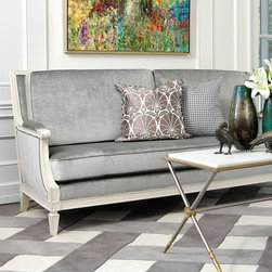 Lille Sofa - Grey - The cloudy luxury of silver velvet tightly clothes this tailored sofa, a comfortable French-inspired piece for the country breakfast room or the European uptown loft alike.  Lacquered in ivory, the frame plays hostess to lush stuffed cushions with neat piped edges, while bold spade feet invoke the sensibilities of practical yet perfect vintage furnishings.
