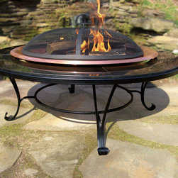 Monterey Granite & Copper Fire Pit - The Monterey copper bowl with black granite surround will make a sleek and practical addition to your patio. Measuring 40 inches in diameter, this fire pit provides a great place for friends to gather on cool fall evenings. Ideal for a night of entertaining, or creating lasting memories with family and friends, all you have to do is add fire. The Monterey's copper bowl comes with a metal grate to keep logs off the bottom and you'll be glad you have the (also included) spark guard when the fire really gets going.