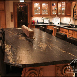 Tuscany Style Kitchen with beautiful textured granite - Beautiful Tuscan style kitchen with river washed cyclone granite.  The amazing vision is from Doug Bell of Bell Construction who completed all the renovations, design, carpentry & tile work.  Doug found the slabs available in the indoor granite & marble slab gallery at Custom Marble & Granite of Butler, PA.  Custom Marble & Granite created all the amazing counter tops with the rare and very hard to find river washed cyclone granite.