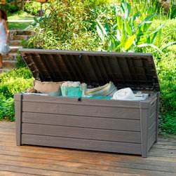 Keter - Keter Brightwood Resin 120 Gallon Outdoor Storage Deck Box - 206042 - Shop for Sheds and Storage from Hayneedle.com! The Keter Brightwood Resin 120 Gallon Outdoor Storage Deck Box will outfit your deck or patio with great seating and great storage. Make your outdoor living space tidy and appealing with a sturdy attractive deck box from Keter Plastic. Store all your outdoor essentials in one easily accessible container that blends seamlessly into your homes outdoor decor. This box allows you to toss furniture cushions table covers candles cleaning supplies pool or beach toys and other outdoor accessories into a handy container for quick retrieval when you need them.This 120-gallon container makes tidying up the deck or patio super simple. The durable resin box also doubles as a bench accommodating two adults on its sturdy top. The storage containers convenient side handles allow for easy lifting whether you're cleaning the deck or making room for guests. Its lid opens automatically thanks to dual pistons -- a feature youll really appreciate when storing numerous items or cleaning up after a barbecue.About KeterFor over 60 years Keter Plastic has proven its commitment to innovation quality and design by continually meeting changing needs and trends. Keter's product range reaches a consumer base across the world focusing on outdoor furniture and storage with a commitment to the environment.