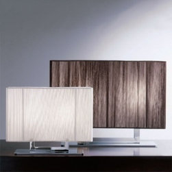 """Clavius table lamp - The Clavius collection consists of lamps with chrome plated frames and handmade silk thread lampshades. They are available in ivory white, black and tobacco. The lamp shade has an opal acrylic diffuser. The series includes table, ceiling, wall and floor lamps as well as pendant lights.  Clavius table lamp: It consists of a chrome plated frame and a silk thread rectangular lampshade. The Calvius table lamp is available in two sizes.  Product description:  The Clavius table lamp from the Axo light collection consists of lamps with chrome plated frames and handmade silk thread lampshades. They are available in ivory white, black and tobacco. The lamp shade has an opal acrylic diffuser. The series includes table, ceiling, wall and floor lamps as well as pendant lights.  Clavius table lamp: It consists of a chrome plated frame and a silk thread rectangular lampshade. The Calvius table lamp is available in two sizes. Details:                         Manufacturer:                         Axo Light                                         Designer:                         Manuel Vivian                                         Made in:            Italy                            Dimensions:                         Small: Height: 9.8"""" (25 cm) x width: 15.7"""" x 4.7"""" (40 x 12cm) x Overall height: 12.6"""" (32 cm)             Big: Height: 13.8"""" (35 cm) x width: 23.6"""" x 5.9"""" (60 x 15cm) x Overall Height: 18.1"""" (46 cm)                                         Light bulb:                                     Small P: 2 x 60 W - incandescent light bulbs (not included)             Big G: 2 x 100W - incandescent light bulb (not included)                                         Material             silk, chrome plated metal             Designer Manuel Vivian:  Born in Venice in 1971, his interest in design started when he was very young, in particular with reference to blown glass, also thanks to his family business. After succeeding in making the first projects in glass, """