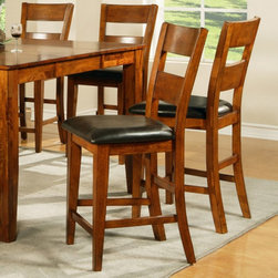Steve Silver Co. - Steve Silver Mango Counter Height Dining Chairs - Light Oak - Set of 2 - SSC959 - Shop for Dining Chairs from Hayneedle.com! With the same appeal of the Mango Side Dining Chairs in fashionable counter height Steve Silver Mango Counter Height Dining Chairs are a smart option for both quality and style.Built using sustainable mango wood these appropriately named chairs are furniture you'll be pleased to own. Stability is added through the corner block and tongue-and-groove construction while the classic Light Oak finish is the result of a complex multi-step process. Vinyl-covered seat cushions in rich brown provide comfort. The casual style is perfect for an informal dining room or kitchen. The chairs measure 18W x 21D x 44H inches with a 24-inch seat height.A coordinating table benches and a server are also available in the Mango Collection so you can choose the pieces that meet your needs. Please note: This item is not intended for commercial use. Warranty applies to residential use only.About Steve SilverSince its founding in Forney Texas in 1987 the Steve Silver Company has had a simple focus: to provide the best quality product at an irresistible price back it up with uncompromising service and continue to improve every day. As one of the premier suppliers of dining sets and occasional furniture in the country Steve Silver is proud to make you the customer its top priority utilizing state-of-the-art equipment proven operating procedures and over 500 000 square feet of facilities. You'll feel equally proud displaying furniture from the Steve Silver Company in your home.