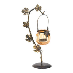 KOOLEKOO - Autumn Harvest Candleholder - A lovely candle accent for your fall decor! The Autumn Harvest Candle Holder features a metal base with climbing leaves that curves upward. Hanging from the base is an orange glass pumpkin candle cup that will shine with warm glow when you add the candle of your choice.
