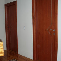 European doors, exterior & interior - Private residence in Muttontown, NY - Solid wood Interior door model STEEL (iO collection) in dark Cherry finish decorated with metal inserts, crafted in Italy