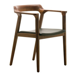 Nuevo - Nuevo Caitlan Dining Chair - HGEM225 - Shop for Dining Chairs from Hayneedle.com! ?The Nuevo Caitlan Dining Chair is a dark rich piece with a soul of its own. The frame is crafted from the finest wood in your choice of ?Black or Walnut finish. The leather-upholstered seat is comfortable without overpowering the overall old-world charm of the piece. Though a dining chair by design the Caitlan Dining Chair is more than suitable for studies offices or home libraries and brings a dash of the debonair to any room. No assembly is required. Nuevo guarantees this product with a one year manufacturer's warranty. About NuevoOne of the most exciting contemporary design companies in the market Nuevo has made a name for itself with its unique approach to professional-quality home furnishings. Creating pieces with a thoroughgoing contemporary edge Nuevo never fails to make a fashionable statement of the highest construction value.