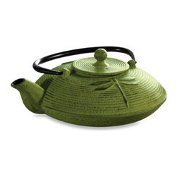 Epoca International Inc. - Primula Tea Cast Iron 28-Ounce Teapot in Green - Create the perfect cup of tea with this graceful cast iron tea pot. Its interior is coated with enamel and includes a removable stainless steel loose tea basket for brewing tea exactly to your liking.