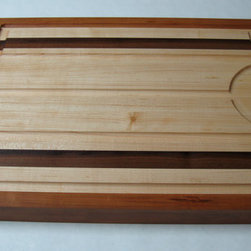 Master Carving Board by Omni Butcher Blocks - Deep-set grooves in this carving board ensure that juices have a place to flow and keep your prime rib sliding around the table. The cool stripe design is an added bonus to this heavy-duty kitchen tool.
