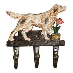 Cast Iron Dog Wall Hook - A whimsical accessory for the animal lover, the Cast Iron Dog Hook is perfect to hang in a mud room or entry way for coats. The hook features a perfectly painted pooch and a tulip in a pot. Quite a darling little accessory that is not only adorable but functional too.