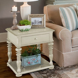 Universal Furniture - Paula Deen Rectangular End Table in Linen - What a great looking table to set next to your sofa or favorite chair!  The Paula Deen Rectangular End Table from Universal Furniture is particularly attractive in this linen finish.  The perfect place for a lamp, the remote, or just about anything else, this rectangular end table also has a storage drawer and a display shelf at the base where you can keep magazines and other reading material.  The hardwood with birch veneers construction makes this one durable little end table.