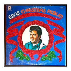 "Glittered Elvis Presley Christmas Album - Glittered record album. Album is framed in a black 12x12"" square frame with front and back cover and clips holding the record in place on the back. Album covers are original vintage covers."
