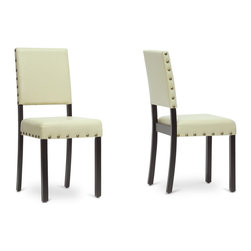 Baxton Studio - Baxton Studio Walter Cream Modern Dining Chair Set of 2 - The Walter Designer Dining Chair is full of low-key, adaptable style. Chinese-made, the Walter Contemporary Dining Chair features delightful cream faux leather seating, foam cushioning, and a dependable solid wood frame finished with black lacquer. Antiqued brass upholstery tacks line the perimeters of the seat and backrest for a pop of added flair. Maintain the Walter Chair's good looks by simply wiping the surfaces with a damp cloth. This design requires assembly. For a unified look throughout your home, we also offer matching Walter Bar Stools and Counter Chairs (each sold separately), which are also available in dark brown.