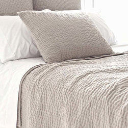 Seychelles Quilt - Deeply textural due to its simple grid of tiny topstitching holding together the layers of luxurious cotton, the Seychelles Quilt is flawless in look and luxurious in feel.  The exquisite neutral quilt is made from natural fibers and crafted with sensitivity and skill, yielding a sought-after piece: a solid-colored coverlet that evidences thoughtful construction but has a simple, timeless design.