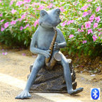 """Frog Bluesman with Speakers - Dazzle the party with some jazz selections provided by this saxophone playing frog… Wait! Is the hidden speaker channeling your cell phone or blue tooth device? Why, yes it is, but let's not break that news to the frog. Connects easily to any bluetooth unit. Loud & clear, 10 watt speaker hidden inside the base. Dimensions: 16.5""""w x 14""""d x 20.5""""h"""