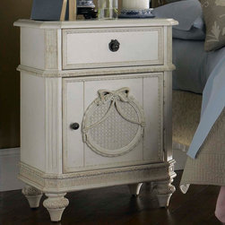 Lea Industries - Lea Emma's Treasures Nightstand in Vintage White - Inviting, casual and comfortable easily describes Emma's Treasures from Lea Furniture. Traditional styling mixed with a cozy time-worn appearance creates a collection of youth furniture sure to please any age girl. The distressed vintage white color finish, antiqued pewter-color hardware, the use of cane and crystal-cut mirrors all help create the shabby chic appeal of this group. Special features include vintage patterned drawer liners and hidden compartments on select pieces. Unique pieces include a vanity with bench, a mirrored door chest and a desk that can double as a larger vanity. Take a look at Emma's Treasures and create a room your child will treasure for years to come. And, as always, Emma's Treasures comes with the quality you expect from Lea Furniture. Safety is one of the key elements parents look for when buying products for their children. As a supplier of children's furnishings, we are committed to ensuring our products meet or exceed the safety requirements defined by the Consumer Product Safety Commission and the ASTM. Design and function combined with safety features makes the Emma's Treasures collection an ideal choice for any child's room. - 606-412.  Product features: Belongs to Emma's Treasures Collection; Nightstand; 1 Door; 1 Drawer; 1 Adjustable Shelf; Crafted from solid wood; Select veneers and wood solids for a high quality end product; Use mortise and tenon joinery to ensure strength and stability; Have veneer tops and end panels to prevent cracking and splitting over time; Distressed vintage white finish. Product includes: Nightstand (1). Nightstand in Vintage White belongs to Emma's Treasures Collection by Lea.