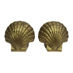 Vintage Brass Shell Bookends - This pair of brass bookends have a wonderful patina. Recently used in a unique photo shoot, they are sure to add warmth and interest to any interior. Perfect for any beach inspired home.