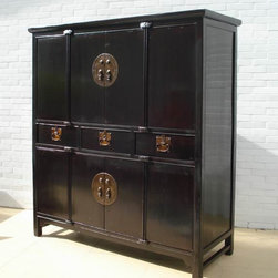 Large Living Room - This large beautiful cabinet was used to store clothes and bed ware such as comforters and linens by a landowner family from Zhe Jiang Province in South part of China. With the original brassware and four symmetric posts, this magnificent antique cabinet adds Asian classics and elegancy to a family room, dinning room or bedroom. It has 4 shelves and three drawers, providing ample storage room. The structure restoration was minimal. Two outer side doors on the top and bottom can only be opened from inside.
