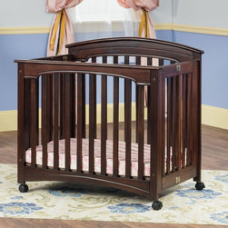 Child Craft - Child Craft Stanford Mini Folding Crib and Mattress - Cherry - F61301.85 - Shop for Cribs from Hayneedle.com! The times they are a-changing and as your little one grows up you need to change with them and the Child Craft Stanford Mini Folding Crib and Mattress - Cherry is an easy way to do just that. This versatile crib features a solid wood body and rich cherry finish that's going to be a welcome addition to any nursery. Two adjustable positions for the included mattress gives you a bassinet when they're smaller and as they grow you can lower the mattress to become a standard crib. When they've outgrown it simple hinges on the side allow you to fold it flat for easy storage. A 3-in. foam mattress is included and swiveling casters let you get the perfect position in any room.Every Child Craft crib meets or exceeds government safety standards and is certified by the Juvenile Products Manufacturers' Association (JPMA).About Child CraftFounded in 1911 in Salem Indiana Child Craft Industries is a family-owned American company synonymous with quality and value. Manufacturer of cribs and children's furniture the company is very strongly committed to product standards and safety and combines beautiful design and innovative features with sturdy construction and superior craftsmanship. The principles of quality and integrity that served to guide the company for nearly 100 years remains unchanged even today and Child Craft continues to be a respected name in children's furniture.