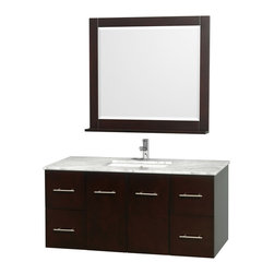 Wyndham Collection - 48 in. Vanity Set in Espresso Finish - Includes matching mirror with shelf. Faucets not included. Four functional drawer. Two functional door. Plenty of counter and storage space. Brushed chrome exterior hardware finish. Single faucet hole mount can be drilled for 3-hole faucets on site. Concealed soft-close door hinges. Fully-extending under-mount soft-close drawer slides. Deep doweled drawers. Unique and striking contemporary design. Highly water-resistant low V.O.C. sealed finish. 12-stage wood preparation, sanding, painting and finishing process. Lifetime warping prevention. Square porcelain undermount sink. White Carrera top. Made from solid oak wood. Vanity: 48 in. W x 21.5 in. D x 22.75 in. H. Mirror: 36 in. W x 5 in. D x 33 in. H. Handling Instructions. Assembly Instructions - Vanity. Assembly Instructions - Countertop. Assembly Instructions - Sink. Assembly Instructions - MirrorSimplicity and elegance combine in the perfect lines of the Centra vanity by the (No Suggestions) collection. If cutting-edge contemporary design is your style then the Centra vanity is for you - modern, chic and built to last a lifetime. Available with green glass, pure white man-made stone, ivory marble or white Carrera marble counters, and featuring soft close door hinges and drawer glides, you'll never hear a noisy door again! Meticulously finished with brushed chrome hardware, the attention to detail on this beautiful vanity is second to none.