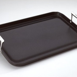 "All-Clad - Hard Anodized 13"" x 20"" Nonstick Grande Griddle - The Nonstick Hard Anodized Grande Griddle makes an ideal kitchen companion when entertaining a crowd. The Grande Griddle's black, hard-anodized surface resists sticking and presents an attractive contrast to the polished stainless steel handles and rivets. The three-ply construction promotes even heat distribution, making this griddle a preferred choice for professional chefs and home cooks alike. The handles stay cool during cooking, and the channel inside the pan's raised edge collects fat and juices. Features: -Specialty Cookware collection. -Extra-large griddle fits over two stovetop burners. -Sophisticated black anodized finish. -Nonstick, utensil-safe anodized stainless steel interior. -Riveted, stay-cool stainless steel handles. -Durable three-ply construction. -Grande griddle, use and care manual, and warranty information. Dimensions: -13"" W x 20"" D, 7 lbs."
