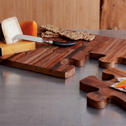 Puzzle Serving Board - This puzzle-shaped serving board can be used in individual pieces or joined together as one large unit.