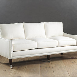 Ballard Designs - Griffin Sofa with Pewter Nail Heads - Foam core cushions wrapped in sumptuous down blend. Sag-resistant sinuous springs for reassuring comfort & support. Available in off-white twill. Special Order in your choice of fabrics. Your choice of leg finish stain. Our Griffin Sofa delivers tailored, timeless comfort that will never step out of style. Hardwood frame is artisan crafted in North Carolina with gracefully sloped track arms defined with double rows of pewter nail head trim. Tapered front legs are hand finished and capped with pewter casters. Griffin Sofa with Pewter Nail Heads features: . . . . .