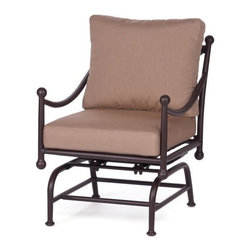 Caluco Origin Rocker Club Chair - The Caluco Origin Rocker Club Chair brings comfort and style to your patio, making it easier than ever to gently rock in peace while enjoying the great outdoors. The rocking chair is built for lasting outdoors with its fully welded, rust-resistant extruded and cast aluminum frame. Like each item in the Origin collection, this chair creates a mood of timeless relaxation. It also features a powder-coat finish in a rich espresso tone, providing attractive style and maximum UV protection. The chair is guaranteed to be comfortable thanks to the included six-inch plush cushion in your choice of color. Nylon glides help the chair move easily without damaging your deck or patio. Includes a 10-year limited warranty. Seat height: 14 inches. Dimensions: 26W x 32D x 36H inches.About CalucoCaluco Patio Furniture is a direct importer of high-end outdoor patio furniture. They specialize in providing Grade A aluminum, teak and wicker furniture, expertly manufactured, and sold to you at affordable prices. Their outdoor patio furniture is shipped directly to their 40,000 square foot facility in San Fernando, California; and from their facility, they ship it directly to you. Their clients choose them for their expertise and their ability to combine high end quality with customer care, without the high-end pricing.