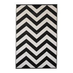 Fab Habitat - Laguna Rug, Black & White (6' x 9') - Chevrons are oh-so-chic, and this eco-stylish rug will display the graphic pattern in such an innovative way on your floor. Crafted using Fair Trade principles, this all-weather rug is a design statement you can feel good about. Its bold pattern is created using high quality recycled woven plastic straws, and comes in a variety of sophisticated colors and sizes.