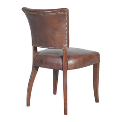 Four Hands - Cigar Leather Upholstered Side Dining Chair - Resembling an English pub chair, this side dining chair makes you think of a smoky pub with pints of ale, music and raucous laughter flowing freely. Even more though, this dining chair is about comfort with its curved supportive back that flares slightly at the top. The seat is also thick with padding. Framework is solid wood upholstered in leather with exposed wood legs that display an antique oak finish.