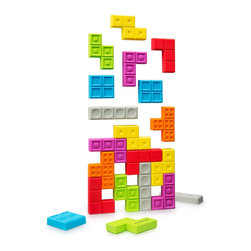 Modern Magnet  Tetris Set - Multiplayer Tetrius set of 21 magnets can be easily split between three fridges. The updated version features chunkier and more attractive pieces with the magnet tuck inside. Multiplayer Tetrius will stick to a fridge, office white board, or any other metal surface.