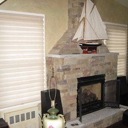 Pearl - Hunter Douglas Vignette Tiered with literise cordless lifting system on both sides of fireplace.  by  Jeffrey Meier Stein of North Shore Decor.