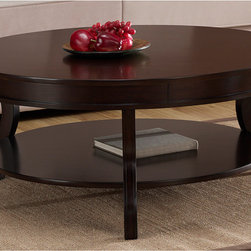 None - Wyatt Coffee Table - This round coffee table by Wyatt uses superior craftsmanship to combine hardwood,MDF,and veneers into a beautiful and durable product. Three solid wooden legs support a shelf ideal for storage underneath a glossy tabletop with an espresso finish.