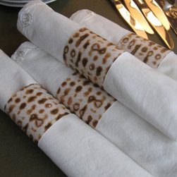Matzo Napkin Rings by Jewish Holiday Shop - These napkin holders are made from strips of paper. If you want to make your own, you can find matzo scrapbook paper on Amazon.