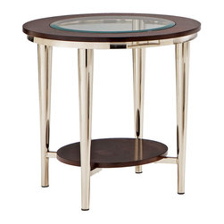 Steve Silver - Norton End Table - Glass Top - 23in. Round - The vivacious Norton Glass - Top End table will add excitement and energy to any room. The espresso wood frame top with inset beveled glass is attached to brush nickel castered legs making a stunning impression on your home.