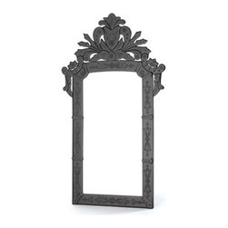 Black Venetian Mirror - Black Venetian glass is starting to pop up everywhere. It's a twist on a style that has held popularity for quite some time. How about this beauty in a powder room?