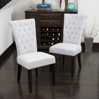 Dinning Chairs - The Paulina dining chair provides style and elegance to any room. The sturdy construction and soft material will have your guests sitting in luxury. Use as a dining chair or as an accent piece in any room or office.