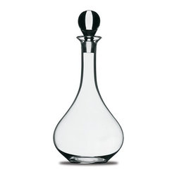 "Peugeot - Peugeot Vendange Decanter - 13""/26 oz. - Made of hand-blown glass, this decanter is used to decant white wines, and mature red wines with complex aromas. Its slightly wider mouth opening leads to a long neck and a round belly that will treat the wine very gently. The glass stopper prevents over-exposure to the air. Capacity is appropriate for a standard 750ml bottle of wine."