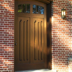 HeartWood Traditional Doors - Custom mahogany door with unique panel design.