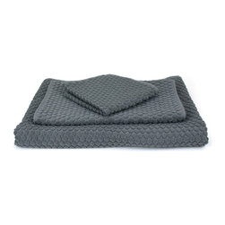 Dotty Towel in Gray - Made of 100% cotton, the gray Dotty Towel is super soft and feels great on the skin. Its hexagonal pattern of raised dots adds a new texture to your drying experience, while its neutral color makes it great for all styles and decors.