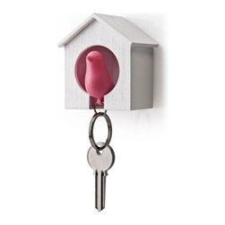 Sparrow Bird House Key Ring - A little birdie told us these adorable birdhouses are just the right place to hold your keys! The Sparrow Bird House Key Ring is a birdhouse shaped key holder and sparrow key ring. The key ring also functions as a whistle. Sticky pads are included on the back of the birdhouse and you can also pop it on a nail.
